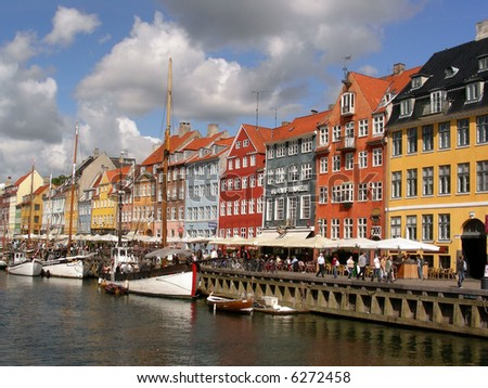 Nyhavn the old popular harbor in Copenhagen with lots of old ships and restaurants