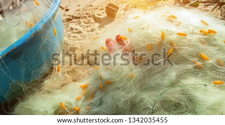 Nylon fishing net with float line attached to small plastic floats in the basket boats on the beach Vietnam #1342035455