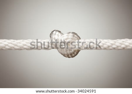 Nylon Rope Knot on a Spot Lit Background.