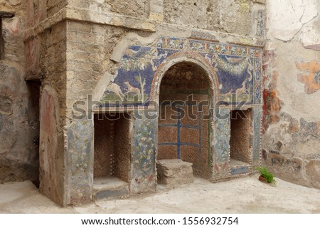 Nymphaeum decorated with  mosaics in summer triclinium. House of the Neptune Mosaic (Neptune and Amphitrite) in Ancient Ercolano (Herculaneum) city ruins.  Naples, Campania, Italy