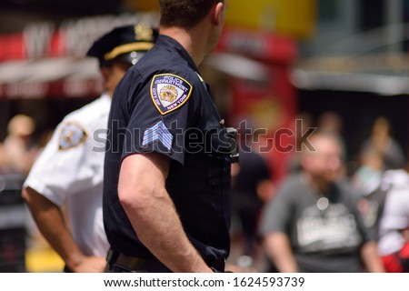 NYPD officers stands guard in Times Square, Manhattan, New York, USA. Safety, security, counter terrorism.