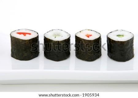 O seafood japonês dos sushi rola com arroz - stock photo