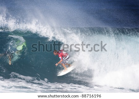 OAHU, HI - CIRCA 2005: Three time world champion surfer, Andy Irons, competes in the Billabong Pipe Masters circa 2005 in Oahu, Hawaii. Andy Irons passed away unexpectedly on November 2, 2010.