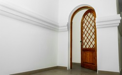 Oak arched doors stand between the rooms in the temple.