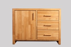 Oak chest of drawers on a light background