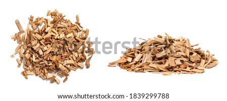 Oak chips for smoking meat and fish isolated on white background. Piles of wood chips from oak front and top view ストックフォト ©