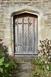 Oak Door and Garden Path of an Old House