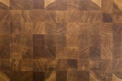 Oak wooden butcher chopping block, natural durable end grain hard wood board texture background pattern close up