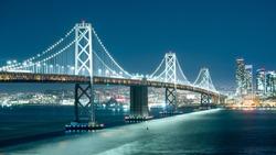 Oakland Bay Bridge and the city light at night.