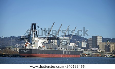 OAKLAND, CA - DECEMBER 26, 2014: MUR Shipping Bulk Carrier AFRICAN JACANA docked at Schnitzer Steel at the Port of Oakland.