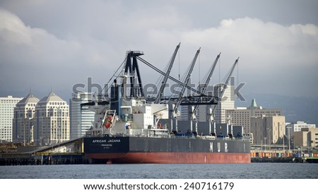 OAKLAND, CA - DECEMBER 29, 2014: MUR Shipping Bulk Carrier AFRICAN JACANA docked at Schnitzer Steel at the Port of Oakland.