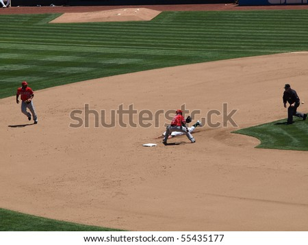 OAKLAND, CA - JUNE 10: A's Cliff Pennington slides into second during a successful steal attempt as the Shortstop covering base.  Baseball game June 10 2010 at the Coliseum in Oakland, California.