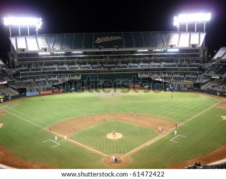 OAKLAND, CA - SEPTEMBER 21: White Sox vs. Athletics: Pitcher Mark Buehrle throws pitch to batter with runner on 1st. Football line visible on field. September 21 2010 Coliseum Oakland California.