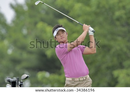 OAKVILLE, ONTARIO - JULY 22:  Japanese-born PGA golfer Ryuji Imada, a former top amateur, follows his tee shot at a Pro-am event at the100th Canadian Open at Glen Abbey Golf Course on July 22, 2009 in Oakville, Ontario.