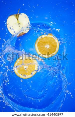 Oange with splashing water. Tropical citrus fruit