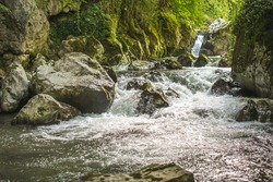 Oasis of peace, water flowing in pure nature scene with stones with no people