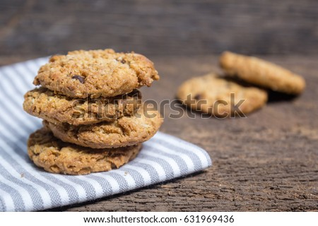 oat and Chocolate chip cookies on rustic wooden table background #631969436
