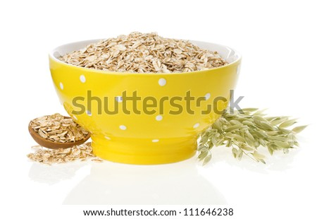 oat flake in bowl and ears isolated on white background