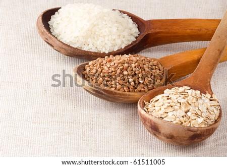 oat flake, rice and buckwheat in wood spoon
