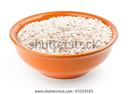 Oat-flakes in bowl on white background