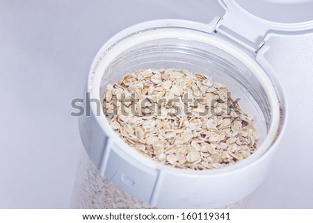 oat flakes in container with white background