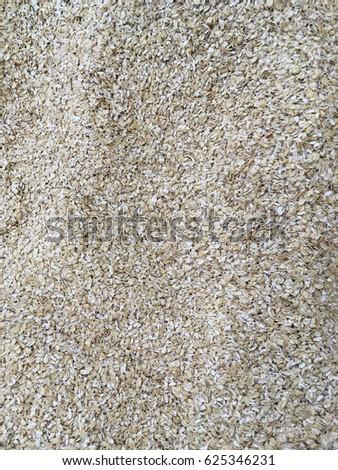 oat flakes. oat flake texture. oat flakes background. oat flake close up  #625346231