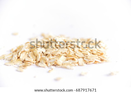 Oat flakes on white background. #687917671