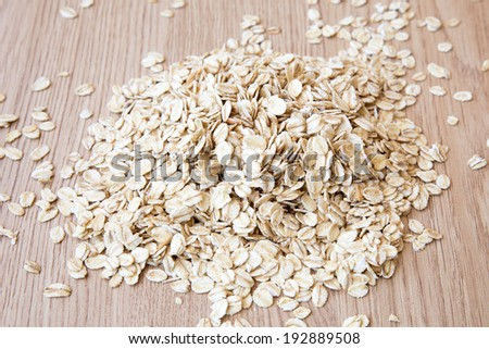 Oat flakes pile on the table #192889508