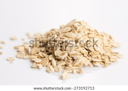 Oat flakes pile on white background #273192713