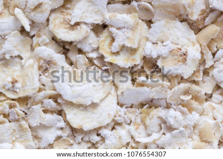 Oat flakes top view close up #1076554307