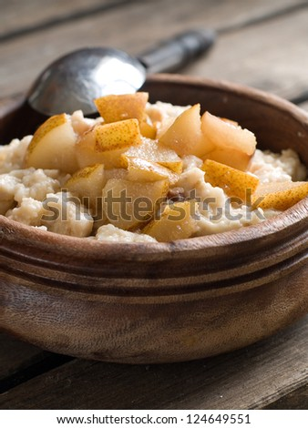 Oat porridge with caramelized fruit, selective focus