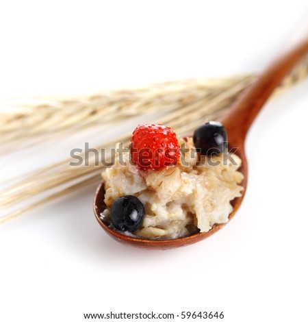 oat porridge with fresh berries on white isolated background