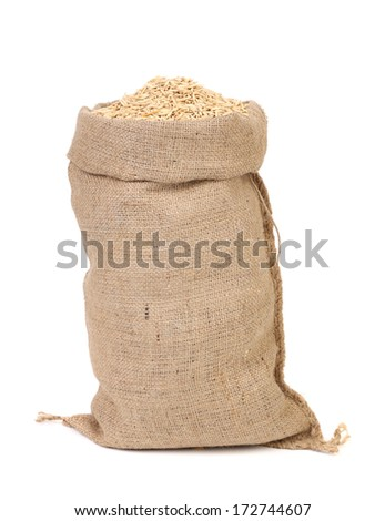oat seed grain in burlap sack bag isolated on white background