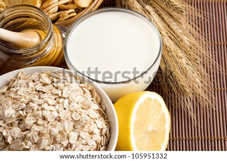 oatmeal and milk on wood background