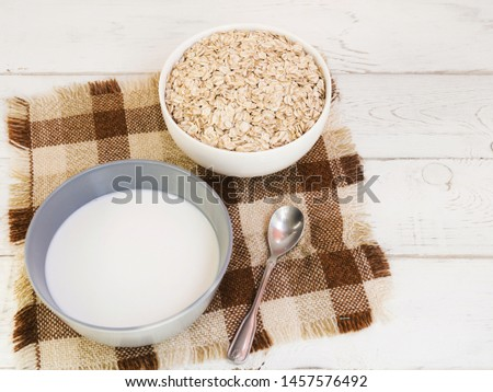 Oatmeal bowl and milk bowl