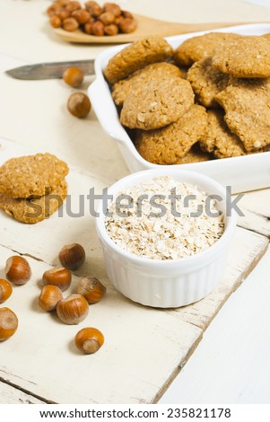 oatmeal cookie chips with hazelnuts on old white wood background #235821178
