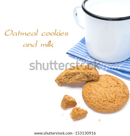 oatmeal cookies and enamel mug of milk isolated on white background