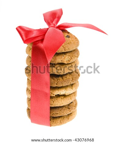 Oatmeal cookies, tied with red ribbon isolated on white background
