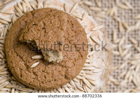 Oatmeal cookies with grains over sacking