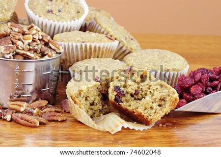 Oatmeal Cranberry Muffins made with dried cranberries, oats, whole wheat flour, pecans and dried cranberries. - stock photo