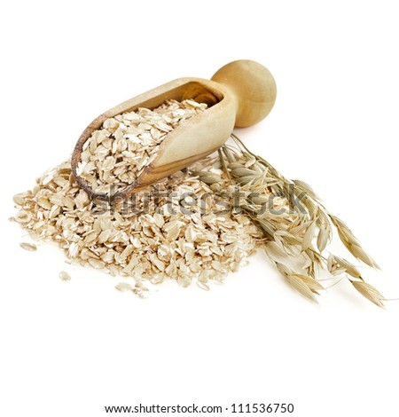 Oatmeal flakes with wooden scoop  isolated on white background
