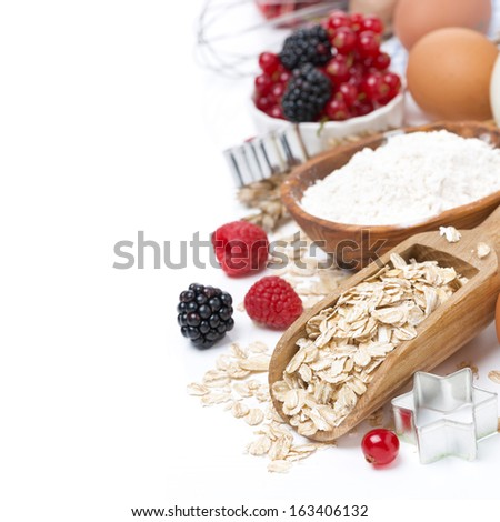 oatmeal, flour, eggs and berries - the ingredients for baking cookies, close-up