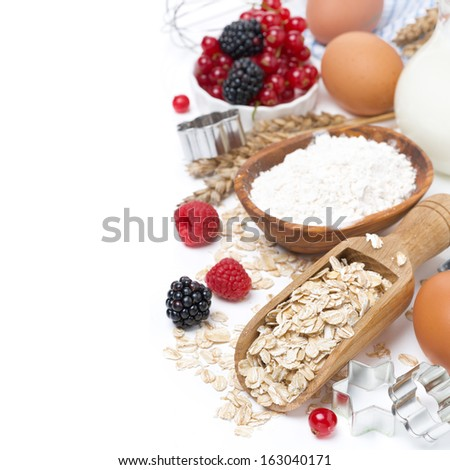 oatmeal, flour, milk, eggs and berries - the ingredients for baking cookies, isolated on white