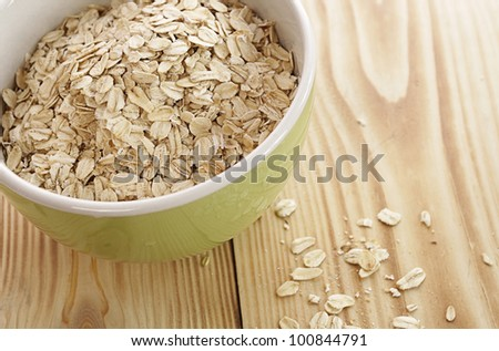 Oatmeal in a green bowl on a wooden table