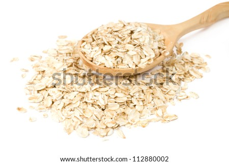 oatmeal in a wooden spoon on a white background