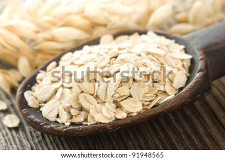 Oatmeal in old wooden spoon
