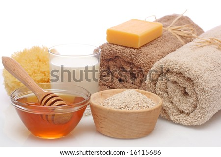 Oatmeal, milk and honey spa isolated on white background