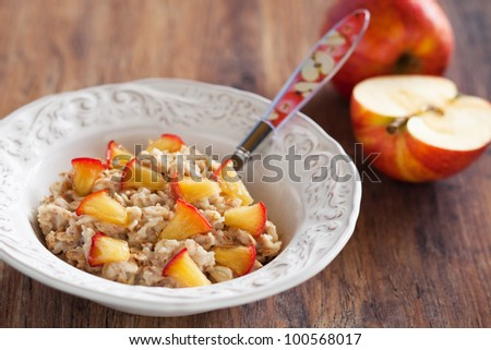 Oatmeal with caramelized apples, selective focus