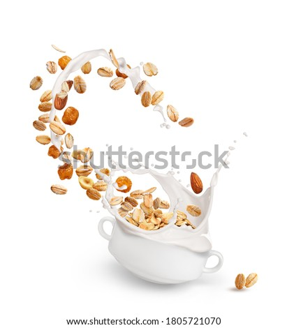 Oatmeal with nuts and raisins. Oatmeal with milk Stockfoto ©