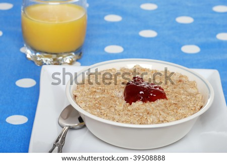 oatmeal with strawberry jam and orange juice